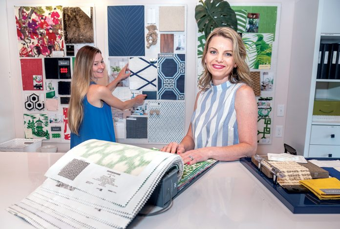 DESIGNING DUO: Janelle Blakely Photopoulos, right, owner and principal interior designer at Blakely Interior Design, with Bernadette Heydt, designer, in their studio in North ­Kingstown.