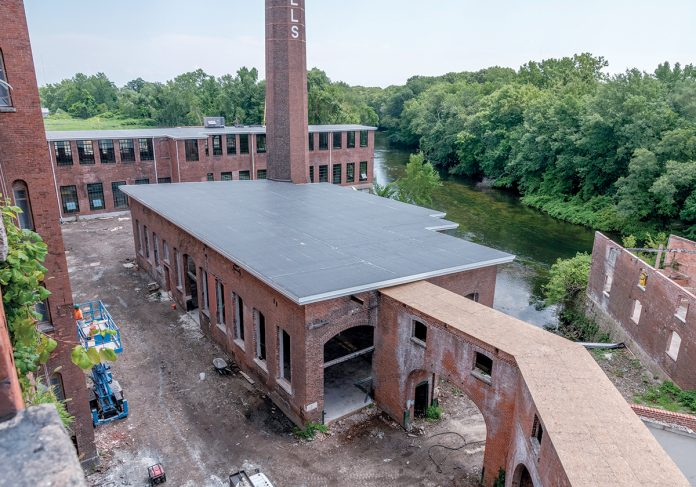 TAKE THEM TO THE RIVER: Pontiac Mills in Warwick is a sprawling former Fruit of the Loom mill complex across from Warwick Mall that is being redeveloped along the Pawtuxet River into residential and commercial space.