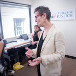 MAKING A DIFFERENCE: Jennifer Wood, foreground, executive director of the Rhode Island Center for Justice, helps provide legal access for those who either cannot afford it or don't know they qualify for it. Helping out are interns Sydney Anderson, left, and Tallia Akay.  / PBN PHOTO/MICHAEL SALERNO