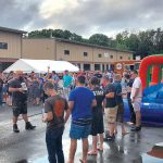BEER BENEFIT: Attendees participate in an event during last year's Augtoberfest at Foolproof Brewing Co. in Pawtucket. This year's Augtoberfest, with a portion of proceeds benefitting the Pawtucket Foundation, will be held Aug. 11. / COURTESY FOOLPROOF BREWING CO.