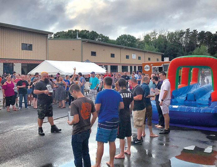 BEER BENEFIT: Attendees participate in an event during last year's Augtoberfest at Foolproof Brewing Co. in Pawtucket. This year's Augtoberfest, with a portion of proceeds benefitting the Pawtucket Foundation, will be held Aug. 11.