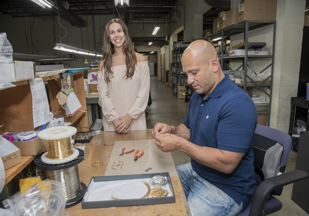 MORE THAN SURVIVING: Since its founding in August 2014, jewelry manufacturer Luca + Danni Inc. has grown to employ 48 people, including owner Fred Magnanimi and Marketing Manager Taylor Franco.