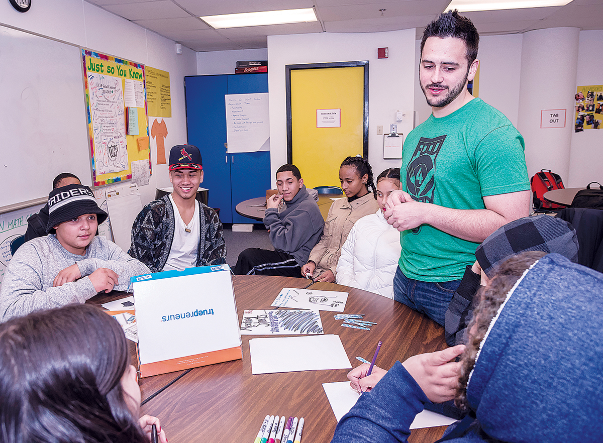 FIRST VENTURE: Truepreneurs founder Brandon Monti teaches students about entrepreneurship at The UCAP School in Providence in 2015. / PBN FILE PHOTO/MICHAEL SALERNO