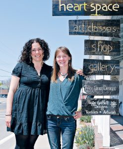 ARTFUL DUO: Felicia Cinquegrana, left, and Paige Gaffett, co-founders of the HeART Space Community Art Center on Block Island, pose outside the center in 2015. / PBN FILE PHOTO/MALCOLM GREENAWAY
