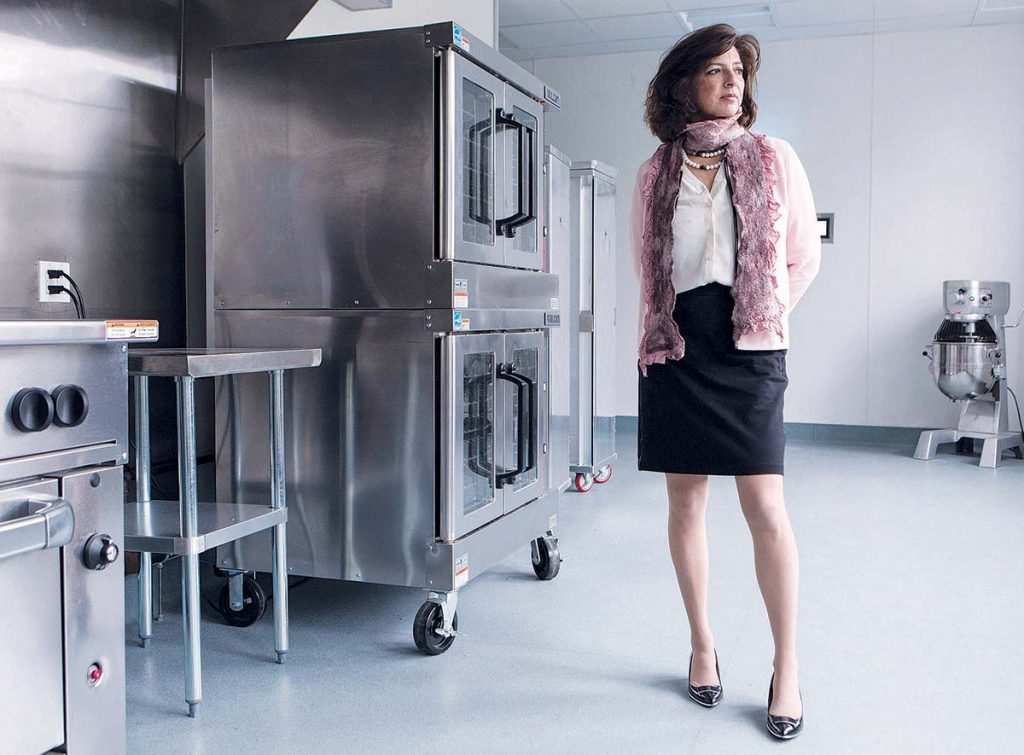 KITCHEN TOUR: Lisa J. Raiola, founder and president of Hope & Main, tours a shared-use kitchen at the Warren-based food-startup incubator, which opened in 2014.