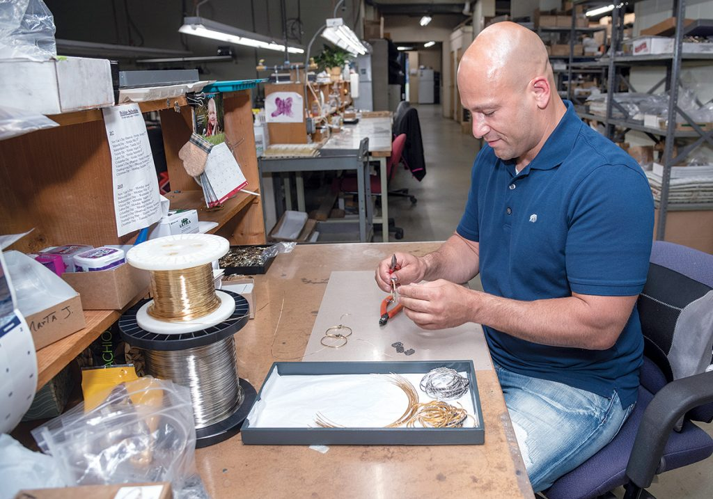 DETAILED DESIGN: Fred Magnanimi, owner of jewelry manufacturer Luca + Danni in Cranston, puts together an elephant bracelet. / PBN PHOTO/MICHAEL SALERNO