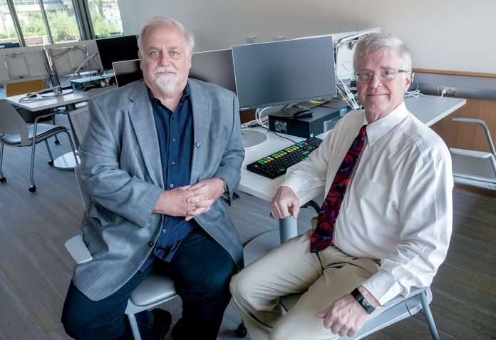 TRAINING NEEDED: UMass Dartmouth professors Tim Shea, left, associate professor ­marketing/business information systems, and Steve White, professor of marketing and international business, oversaw a cybersecurity survey that found employee training lacking.