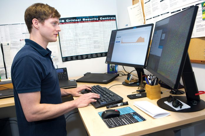 THREAT DETECTOR: Michael Carmack, a cybersecurity analyst with Rite-Solutions in Middletown, assesses security threats.