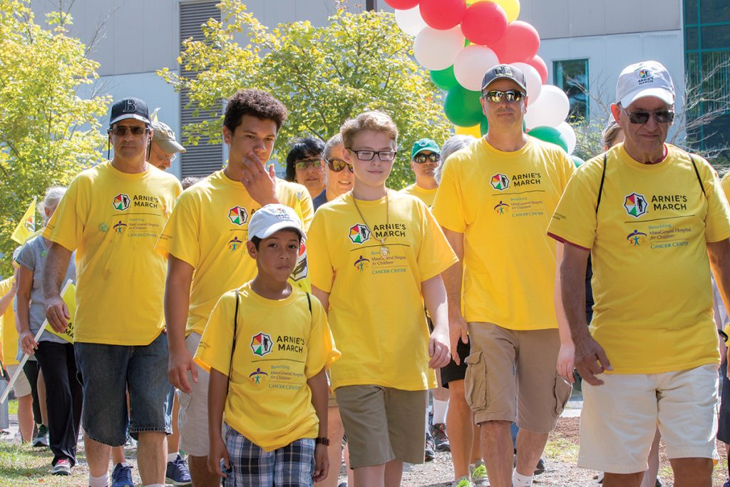MARCHING AGAINST CANCER: Participants walk during last year's Arnie's March Boston event at TPC Boston in Norton. This year's event, benefiting the Massachusetts General Hospital for Children's Cancer Center, will take place Aug. 25 from 9:30 a.m. to noon.