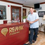 FROM AGENT TO OWNER: Richard Zompa is the owner of four RE/MAX locations in Rhode Island. He is pictured at the North Providence office, which he purchased in 1992.