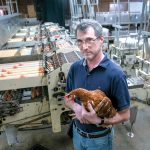 CAGED FEELING: Little Rhody Foods owner Eli Berkowitz says he feels targeted by a new state law that beginning in 2026 will require farms to upgrade their egg-laying chicken cages to allow the birds to move more freely. He operates the only commercial chicken farm that encloses its chickens in cages in the state.