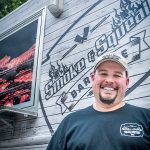 MUCH ­HAPPIER NOW: Smoke & Squeal BBQ owner Adam Batchelder is looking forward to the new year, when licensing requirements for food trucks will be simplified thanks to new regulations. 