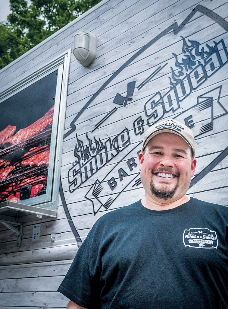 MUCH HAPPIER NOW: Smoke & Squeal BBQ owner Adam Batchelder is looking forward to the new year, when licensing requirements for food trucks will be simplified thanks to new regulations.  / PBN FILE PHOTO/MICHAEL SALERNO
