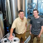 DIFFERENT TASTES: Taproot Brewing Co. owner John Nunes, left, with head brewer Kevin Beachem. The Middletown company is a subsidiary of Newport Vineyards. / PBN PHOTO/KATE WHITNEY LUCEY