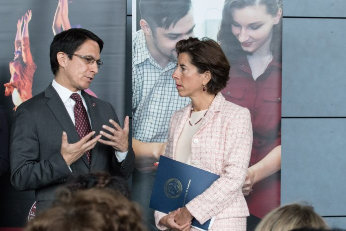 GOV. GINA M. RAIMONDO announced Wednesday a plan to help Rhode Islanders in recovery land jobs and skills training opportunities through a $4 million, federally-funded initiative. Rhode Island College President Frank D. Sanchez, left, will co-chair an ad-hoc committee to generate guidelines which local businesses can follow to be known as