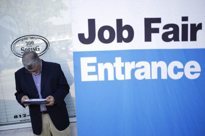 THE UNEMPLOYMENT RATE in the Providence metro area declined 0.5 percentage points year over year to 4.2 percent in July. / BLOOMBERG NEWS FILE PHOTO/LUKE SHARRETT