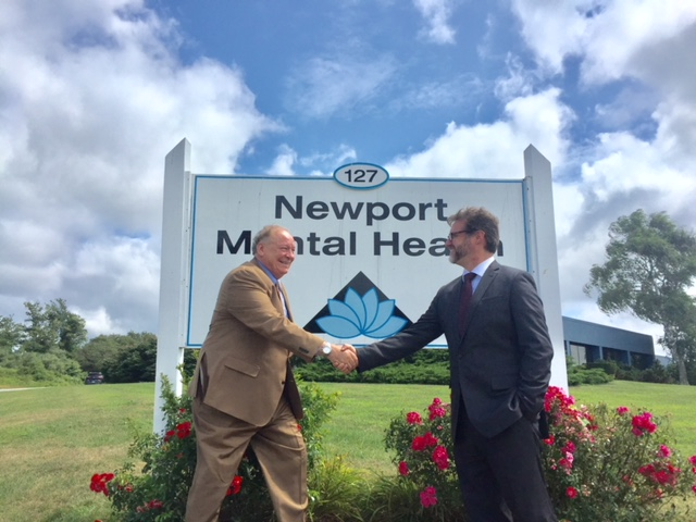 NEWPORT MENTAL HEALTH CEO Jamie Lehane, left, shakes hands with NMH Chief Finance and Administrative Officer Jason Costa after the organization received word of $213,000 in grants. /COURTESY NEWPORT MENTAL HEALTH