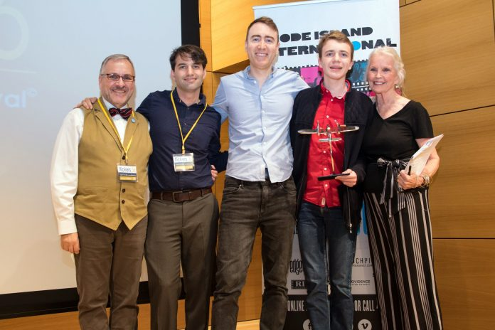 "WINNER OF THE PRIX DU CINEMA SUISSE at the Rhode Island International Film Festival was ""Maximilian,"" from Switzerland. From left, George T. Marshall, RIIFF executive director; Shawn Quirk, RIIFF program director; Nicolas Greinacher, director of ""Maximilian;"" Maximilian Janisch, the film's subject; and Marlyn Mason, actress/screenwriter. / COURTESY RIIFF"