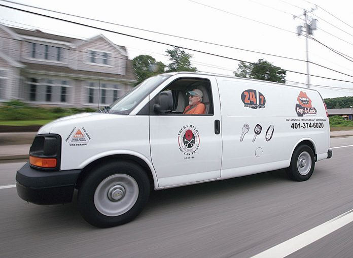 MOBILE LOCKSMITH: Joe Carreiro, owner of Pop-a-Lock in Westerly, travels all over the state in his mobile locksmith shop replacing keys and repairing locks for customers. / PBN PHOTOS/Brian McDonald
