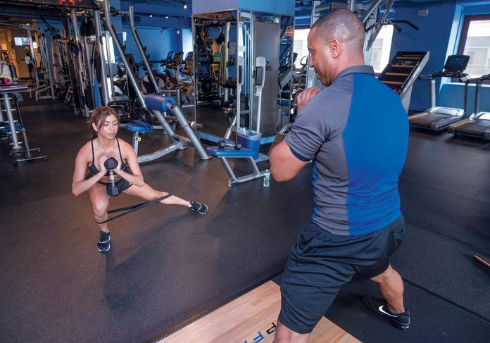 STAYING STRONG: Joe Depena, owner and fitness manager at VP Fitness on Dorrance Street in Providence, works with his client, Alice Negrao of Providence.