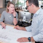 PROPERTY PLANS: Christine M. West, principal at KITE Architects in Providence, looks at some residential plans for a property in Exeter with Albert Garcia, principal.