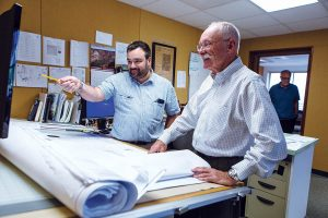 "MORE COMMUNICATION: Estimator Bob Dandeneau, left, talks with Edward W. Burman Jr., president of general contractor E.W. Burman in Warwick. Burman says he would like to see more communication from the state to help ease the frequent and ""challenging"" filing process, such as for building and fire permits.