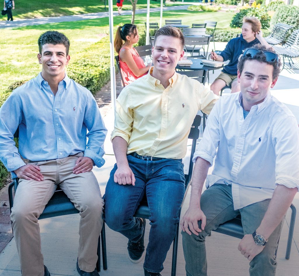 PANGEANS: Pangea.app is a startup created to link college students to gigs through an app. From left, Pangeans (users of the app) and Johnson & Wales University sophomores Marc Marasco and Jack Rittereiser with Pangea.app co-founder and CEO Adam Alpert, a Brown University graduate. In the background are JWU sophomores Deanna Tacmo, left, and Sam Farley.