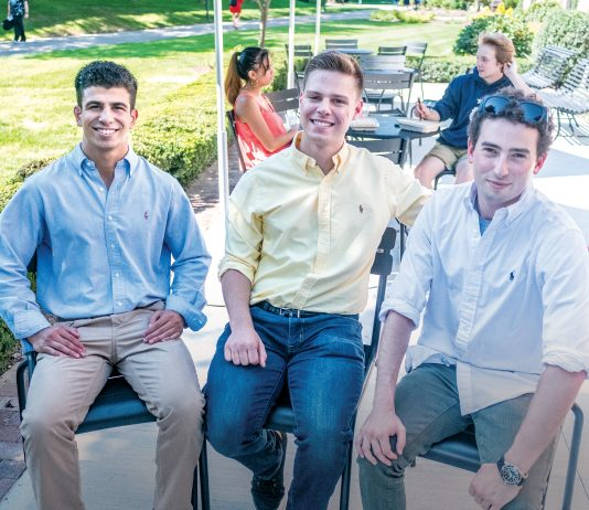 PANGEANS: Pangea.app is a startup created to link college students to gigs through an app. From left, Pangeans (users of the app) and Johnson & Wales University sophomores Marc Marasco and Jack Rittereiser with Pangea.app co-founder and CEO Adam Alpert, a Brown University graduate. In the background are JWU sophomores Deanna Tacmo, left, and Sam Farley. / PBN PHOTO/MICHAEL SALERNO