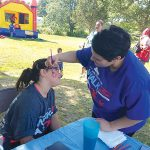 FUN FESTIVITIES: A young attendee receives face painting during last year's Community Connections Walk-a-thon & Family Fun Day. 