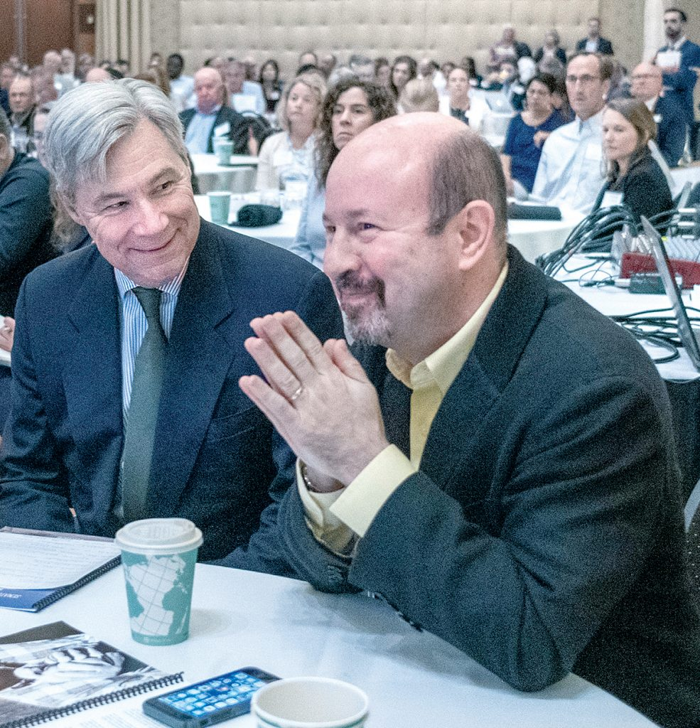FEATURED SPEAKER: Sen. Sheldon Whitehouse, left, speaks with Michael Mann, Pennsylvania State University atmospheric science professor, who was a featured speaker at Whitehouse's ninth annual Energy, Environment and Oceans Leaders Day at the R.I. Convention Center in Providence. / PBN PHOTO/MICHAEL SALERNO