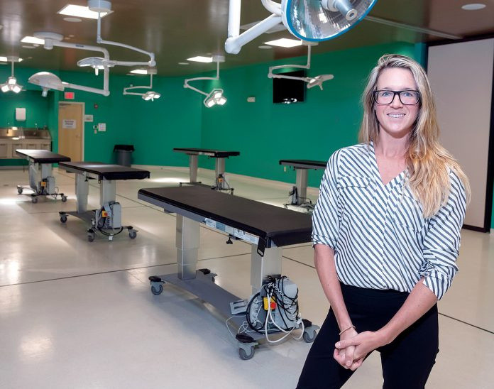 VITAL RESEARCH: Rachel Mulligan, director of lab operations at MedCure in Cumberland, said the company provides access to more people who want to donate their bodies for research who would otherwise be turned away by learning institutions. / PBN PHOTO/MICHAEL SALERNO