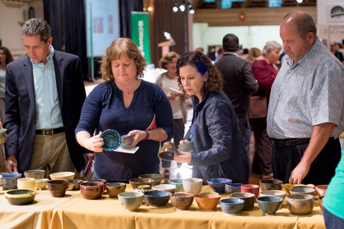 ATTENDEES SELECT BOWLS prior to walking into the Rhode Island Community Food Bank's annual Empy Bowls fundraising event last year. This year's event will be held Oct. 18 at the Rhodes on the Pawtuxet in Cranston. / COURTESY RHODE ISLAND COMMUNITY FOOD BANK