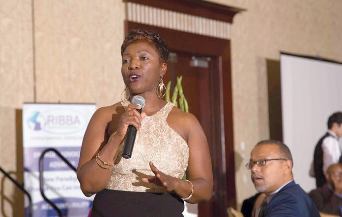 COMMUNITY RECOGNITION: Lisa Ranglin, president of the Rhode Island Black Business Association, addresses the audience during last year's Awards Gala. The association will hold its seventh annual Awards Gala, honoring small-business owners, local leaders and volunteers, in Warwick on Oct. 5, at the Crowne Plaza Providence-Warwick. / COURTESY RHODE ISLAND BLACK BUSINESS ASSOCIATION