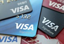 VISA AND MASTERCARD have agreed to pay as much as $6.2 billion to end a long-running price-fixing class-action case brought by merchants over card fees. / BLOOMBERG NEWS FILE PHOTO/ANDREW HARRER