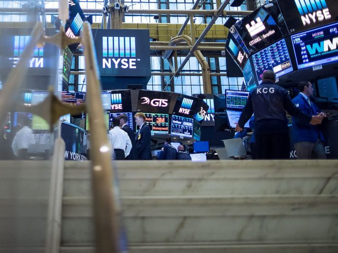 THE S&P 500 Index and the Dow Jones Industrial Average both had record closes Thursday. / BLOOMBERG NEWS FILE PHOTO/ERIC THAYER