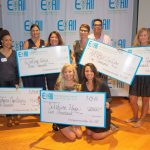 EFORALL SOUTH COAST Accelerator award winners pose with their ceremonial checks at the New Bedford Whaling Museum. / COURTESY ENTREPRENEURSHIP FOR ALL