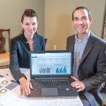 DATA-DRIVEN: Shannon Shallcross, CEO, and Mark Regine, chief epidemiologist for BetaXAnalytics, with a spreadsheet showing health spending. The data report is used to help companies identify where they can save money on health care spending. 