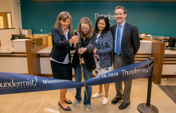 FROM LEFT, Jeanne LaChance, president and CEO of Thundermist Health Center; Pauline Ridlon, patient; Dr. Sapna Chowdhry, medical director of Thundermist Health Center of Woonsocket; and David Valois, chair of the Thundermist Health Center board of trustees, make a ceremonial ribbon cutting at the unveiling of the facility's new patient care space in Woonsocket. / COURTESY THUNDERMIST HEALTH CENTER