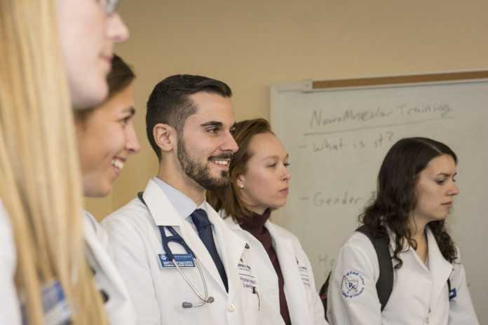 DOCTORATE OF PHARMACY students from the University of Rhode Island will now be eligible to enroll in Johnson & Wales University's physician assistant master's degree studies program and, upon graduation, receive a dual degree from both schools. / COURTESY UNIVERSITY OF RHODE ISLAND/NORA LEWIS
