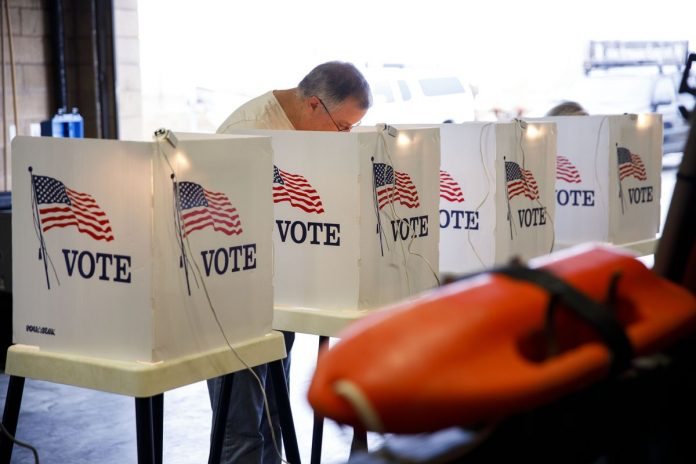 VOTING WILL begin in Rhode Island for the 2018 primary election on Wednesday. / BLOOMBERG NEWS FILE PHOTO/PATRICK T. FALLON