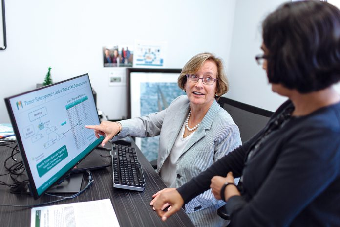 IMPROVED INDUSTRY: Patrice Milos, left, president and CEO of Medley Genomics in Providence, speaks with Niru Chennagiri, director of informatics. Milos said she's seen improvement in the number of industry women in science with Ph.D.s. / PBN FILE PHOTO/RUPERT WHITELEY