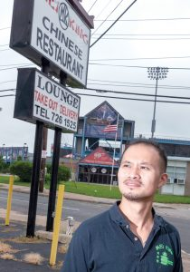 PAINFUL LOSS: Jeff Wang, co-owner of Mei King Chinese restaurant in Pawtucket, across the street from McCoy Stadium, the Pawtucket Red Sox ballpark, said the loss of the team will hurt his business. He's hoping the city finds another use for the ballpark because he said leaving it empty would not only be bad for his business but the neighborhood. / PBN PHOTO/MICHAEL SALERNO