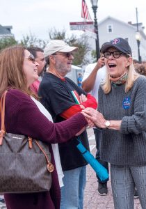 MEET AND GREET: Providence mayoral candidate Dianne Witman, right, shakes hands with Shelly Lariviere of West Warwick while greeting attendees during the Columbus Day Parade on Federal Hill.
