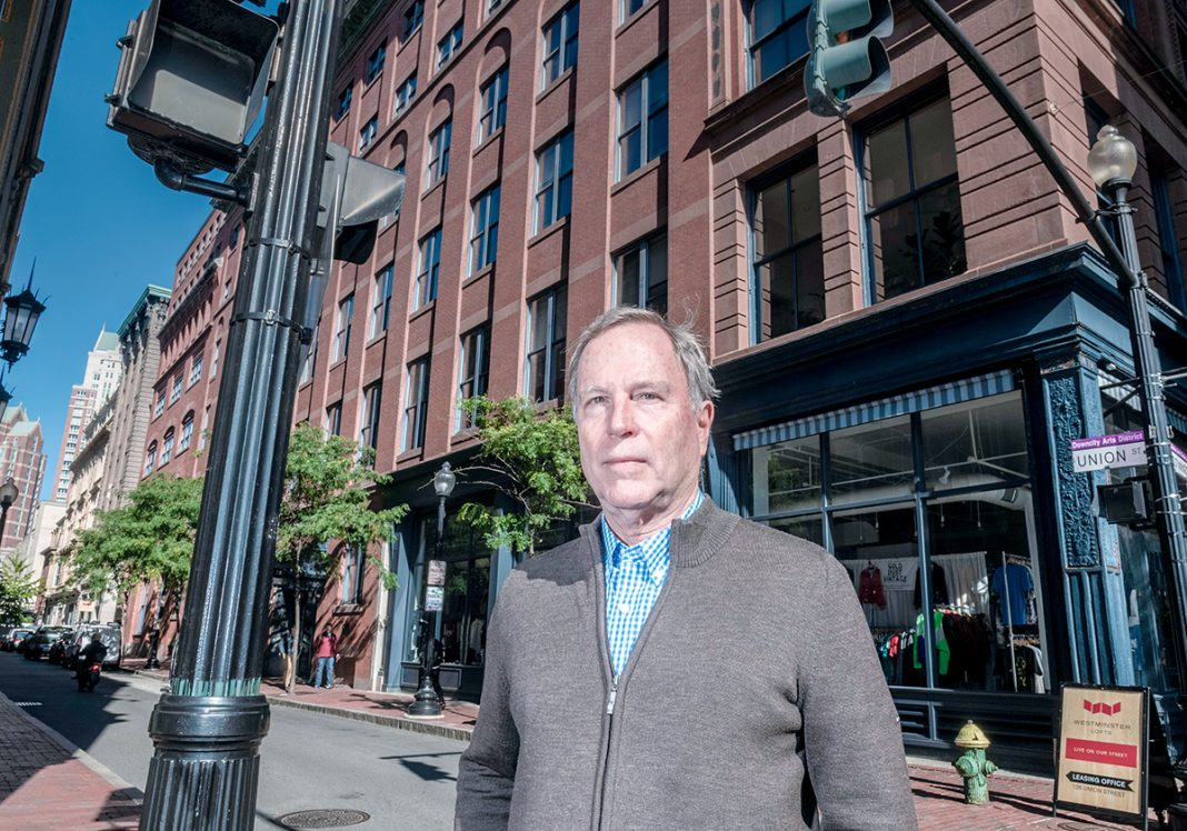 "BUSY DEVELOPER: Arnold ""Buff"" Chace is the managing partner for Cornish Associates LP, which has several ongoing projects in downtown Providence, including three historical buildings on Westminster Street that are being renovated into apartments/retail. Chace stands in front of one of the properties, The Peerless Building at 150 Union St.