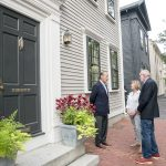 NEIGHBORHOOD ADVOCATES: Mile of History Association board members, from left, William Deveney, treasurer; Linda Getgen, founding member; and Vincent Buonono, president, in front of 52 Benefit St. in Providence. The nonprofit was formed to advocate for the surrounding neighborhood. / PBN PHOTO/MICHAEL SALERNO