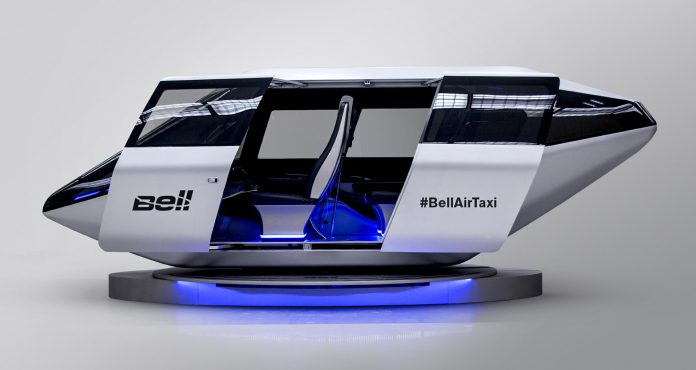BELL HELICOPTER has signed an agreement with Garmin International related to the development and integration of a autonomous vehicle management computer for its VTOL aircraft, seen above as an air taxi. / COURTESY TEXTRON