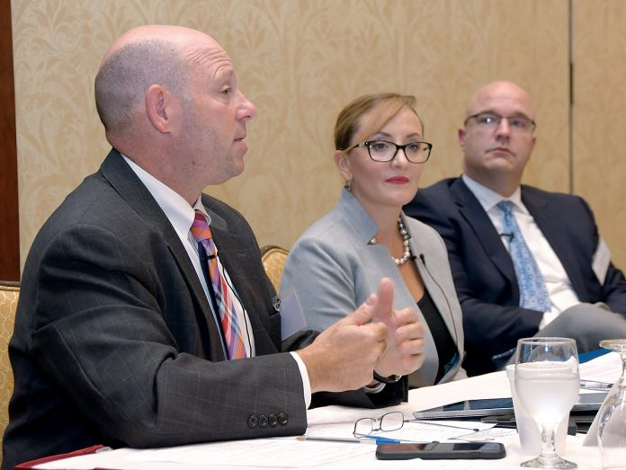 BEING PROACTIVE: Panelists at the 2018 PBN Cybersecurity Summit, held at the Crowne Plaza Providence-Warwick on Oct. 11, discuss ways companies can prepare for and prevent cyberattacks and hackers. From left: Jeffrey Ziplow, cybersecurity risk assessment partner for BlumShapiro; Francesca Spidalieri, senior fellow for cyber leadership at the Pell Center for International Relations and Public Policy at Salve Regina University; and Jason Farmer, senior solution manager for RiskSense. / PBN PHOTO/MIKE SKORSKI