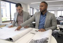 CAREER PATH: Christopher L. Calderon, left, and Edwin A. Montas, project engineers at Gilbane Building Co., benefited from an early introduction to construction. Calderon, who remembers being treated to pizza parties with elementary school classmates at the company's corporate office as recognition for good grades, said giving young people a chance to look beyond the careers of their parents is important. 