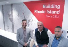 RECOGNIZING ­OPPORTUNITY: ­Gilbane Building Co. Vice President and Rhode Island business unit leader John Sinnott is flanked by Christopher L. Calderon, left, and Edwin A. Montas at the company's Providence headquarters, where Sinnott oversees much of the local recruitment efforts to better match the company's workforce with the local community. 
