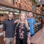 RUNNING SMOOTHLY: Greek market and café Yoleni's co-owners Alexandra Georgiou Philippides, with her sons Jimmy Philippides, right, and John Philippides. The restaurant opened on Westminster Street in downtown Providence last spring.